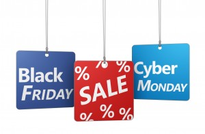 Black Friday and cyber Monday shopping sale concept with sign and percent symbol on hanged tags isolated on white background.