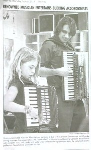 Alex Meixner performs a duet with Carleston Elementary's Josi Oujesky