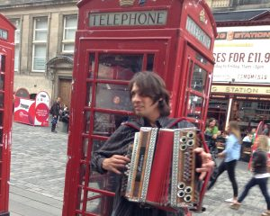 Alex doing a bit of busking on the Royal Mile in Edinburgh.