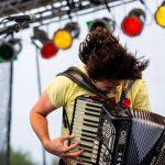 Alex Meixner Playing Accordion - Photo Credit Bob Good